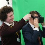 Adam Gwenter showing Mayor of the West Midlands Andy Street the Virgin Trains VR project.