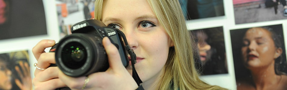 student poised to take a photograph