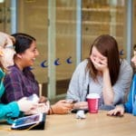 Students chatting in a café.