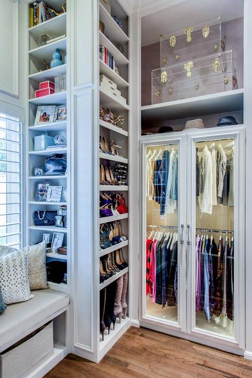What a perfect closet looks like   15 Beautiful walk in closet ideas     The details in this closet are what make the space  the trim work  built in  window seat  and don t forget the lighted wardrobe with glass front doors