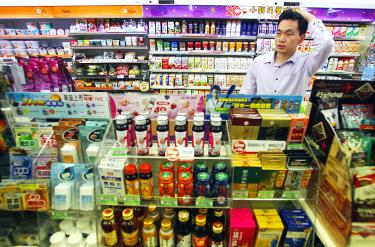 Taiwanese stores take convenience to divine levels   Taipei Times A man looks for items at a convenience store in Taipei yesterday