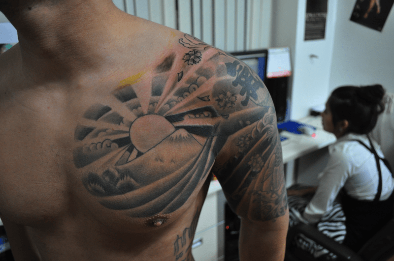 And Rising Chest Sun Clouds Tattoo