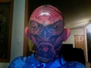 Ugly Face Tattoo On Head