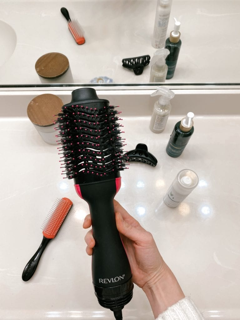 Revlon One Step Hair Dryer Brush Review | Revlon One Step Hair Dryer by popular LA beauty blog, Teacups and Tulips: image of a woman holding a Revlon One Step hair dryer.
