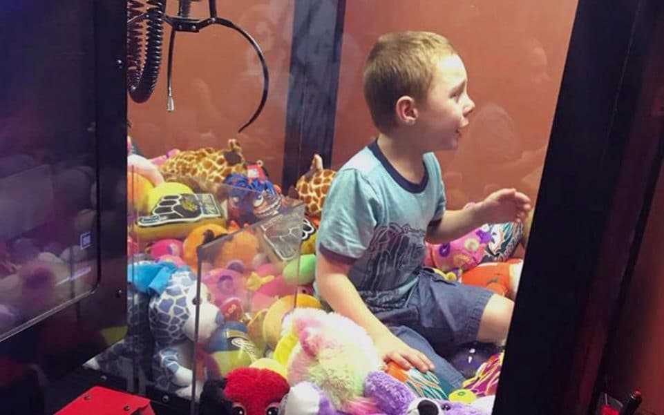 Boy Gets Stuck In Arcade Machine After Trying To Grab