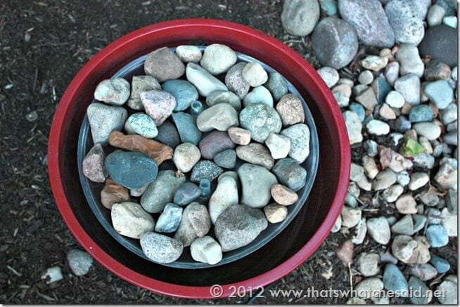 Add rock Base to top of drip pan