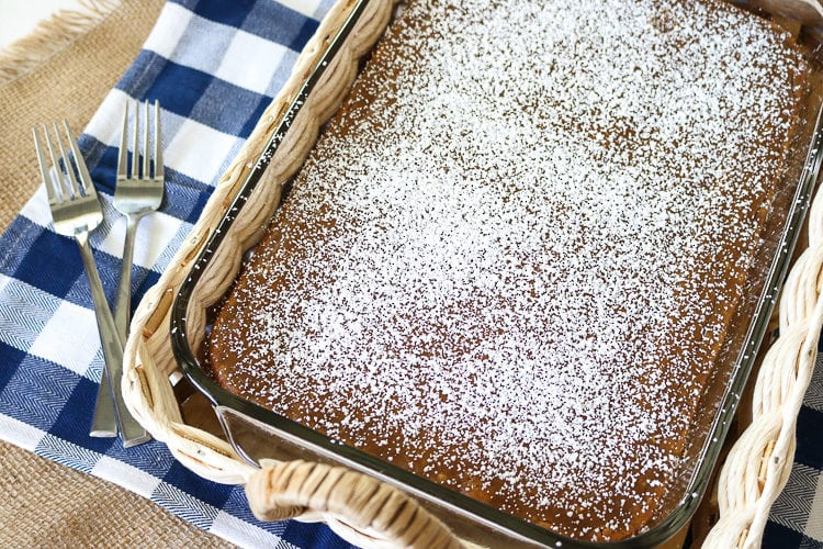 Pumpkin Gooey Butter cake with powdered sugar in a 9 x 11 glass pan