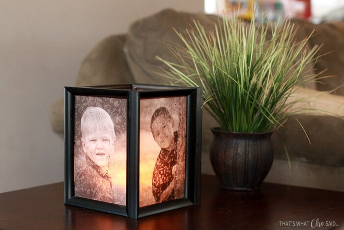 Four picture frames glued in a square with vellum photos. Candle illuminates the center.