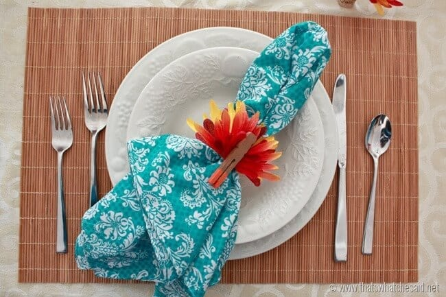 Place setting with turkey napkin rings made from faux flowers and clothespins