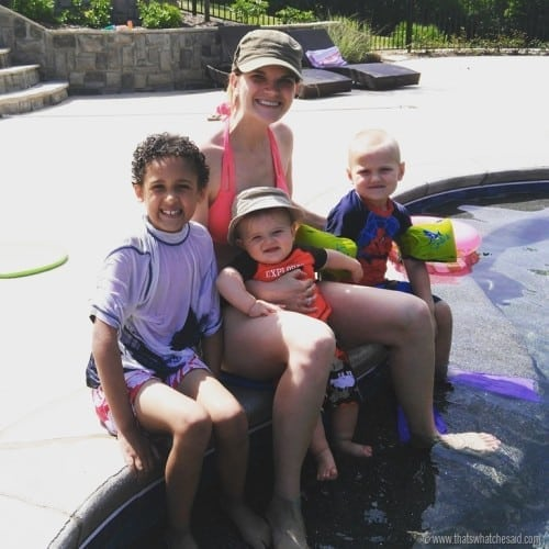 Picture of mom with 3 kids at the pool