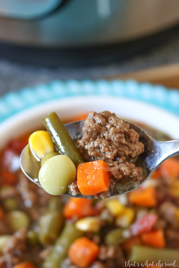 Hearty Veggie Beef Soup made in the Instant Pot - Close up of a spoonful.