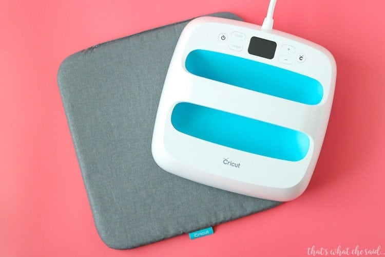 Cricut EasyPress with EasyPress Mat.  This makes using iron on a breeze!  Get the best adhesion with this awesome press that fits perfectly on a shelf!  No bulky equipment here.