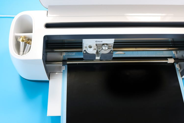 Cricut Maker Machine cutting black iron on for Jack-o-lantern Shirt