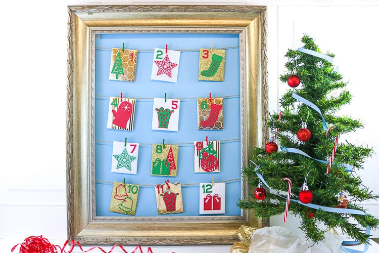 Frame with 12 Holiday Envelopes strung up for 12 days of Random Acts of Kindness