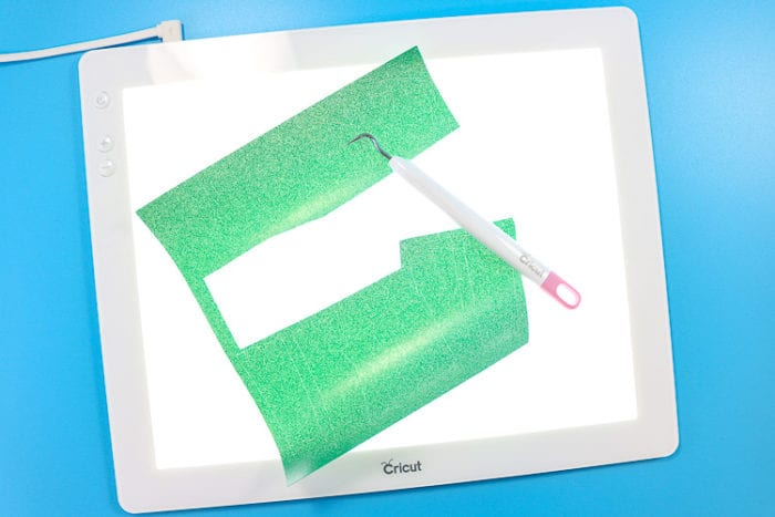 Cricut Bright Pad with Green Glitter Vinyl and Weeding Hook