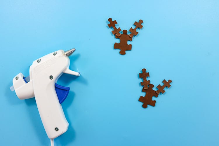 Painted Brown Puzzle Pieces glued together to resemble a reindeer