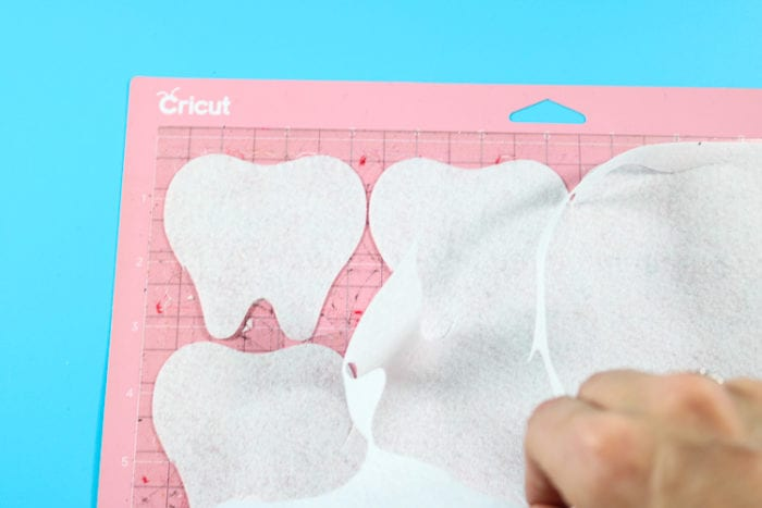 Pink FabricGrip Mat with White Felt. Showing perfectly cut Tooth Designs.