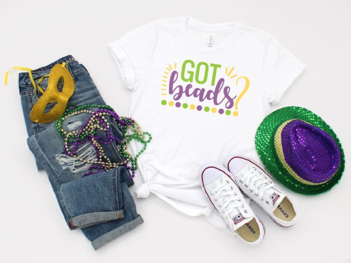 Mardi Gras Tshirt with beads, mask, hat and jeans/converse