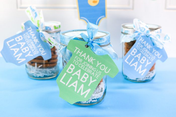 Cookie Jar Baby Shower Favors with Print Then Cut Tags in mason jars wrapped with ribbon