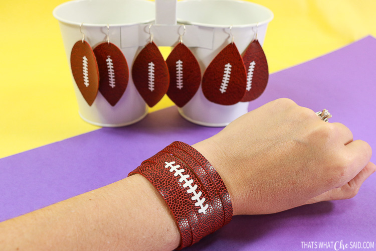 Earrings and bracelet cut from faux football leather