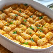 Cheeseburger Tatertot Casserole in white Oval casserole dish ready to be served