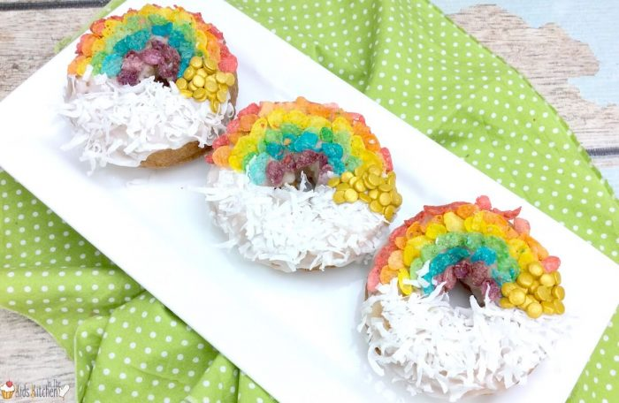 Air Fryer Donuts decorated with Fruity Pebbles in rainbows and coconut as clouds