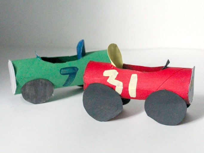 Toilet paper tubes up cycled into racing cars.