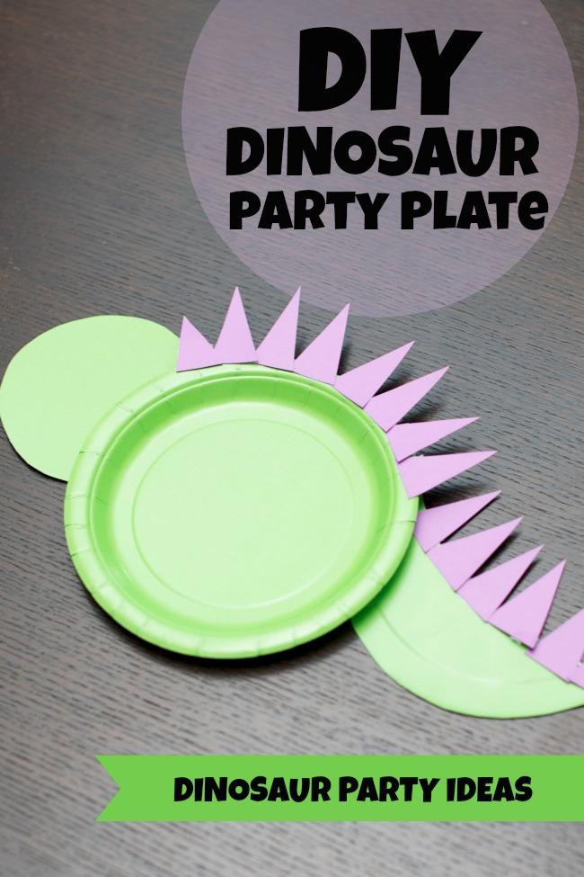 Paper plates cut into the shape of a dinosaur.