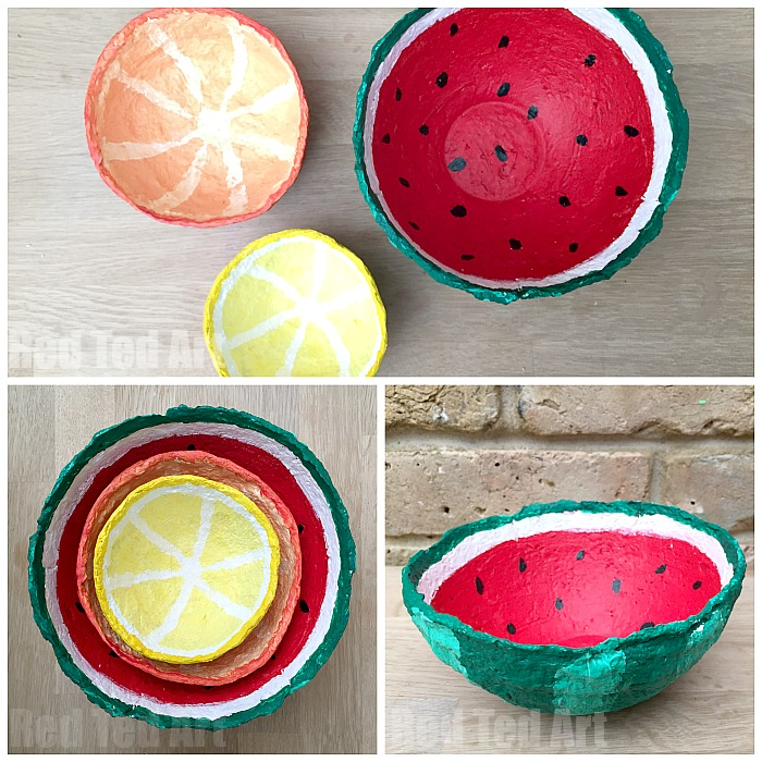 Paper mache bowls that's are painted as cut up summery fruits.