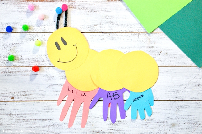 Circles and handprint cut outs out together in shape of a caterpillar.