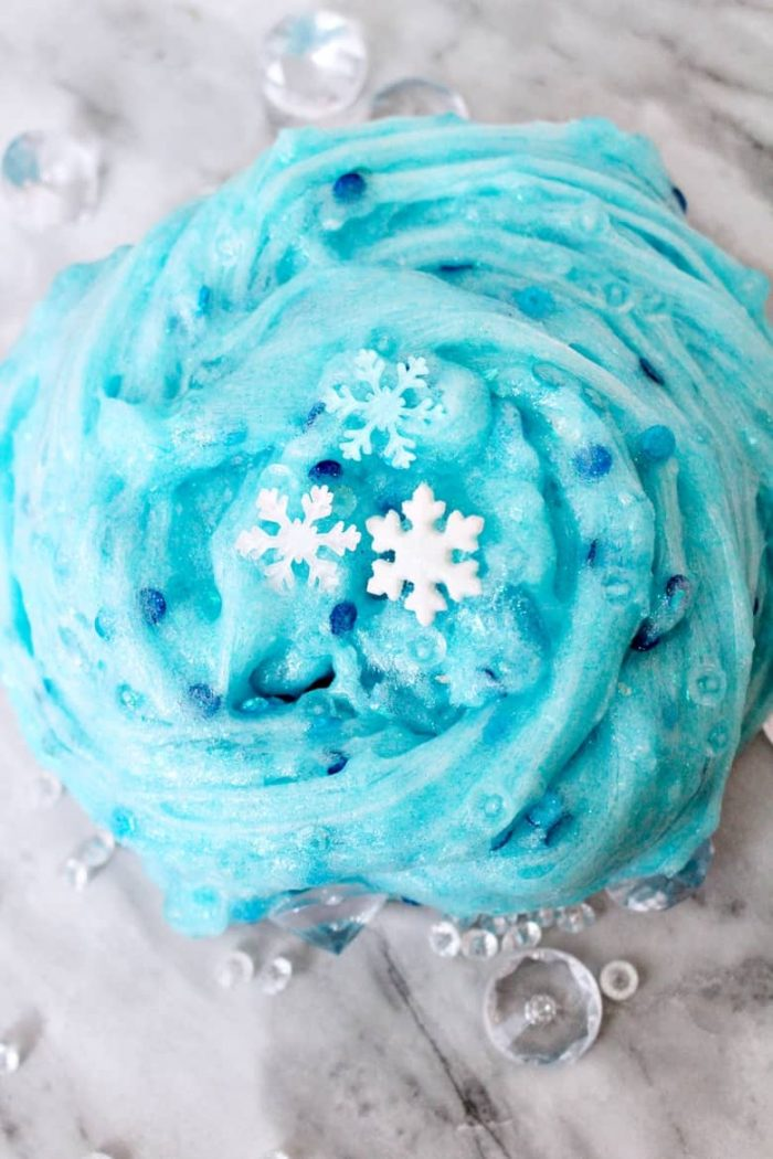 Blue sparkly slime with snowflake charms and blue sequins.