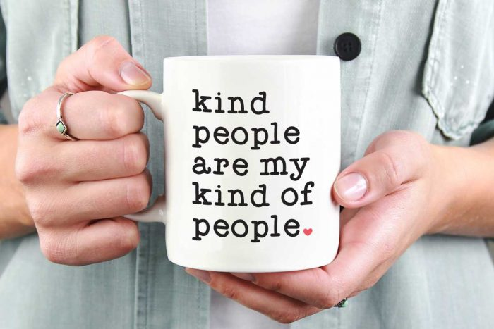 """Woman holding White Coffee Mug with Saying """"Kind People are My Kind of People"""" in Vinyl - Horizontal"""