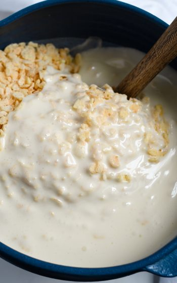 Adding melted butter and marshmallow to Krispies in bowl