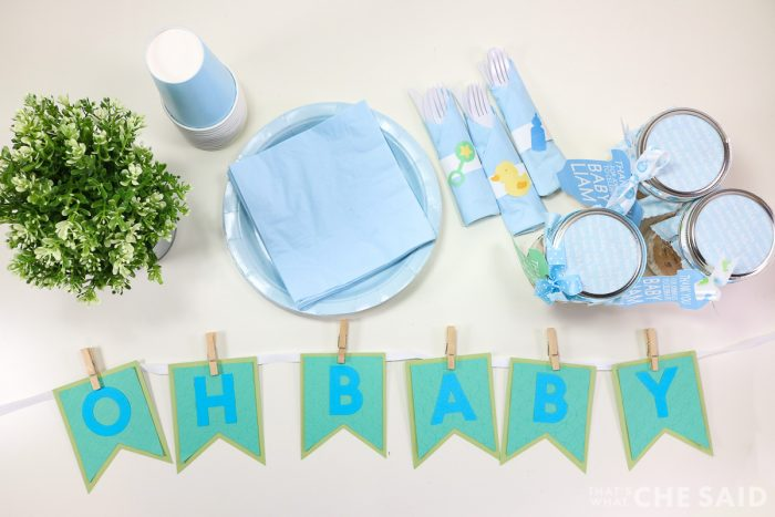 Baby Banner with Baby shower stuff like plates, napkins, and favors