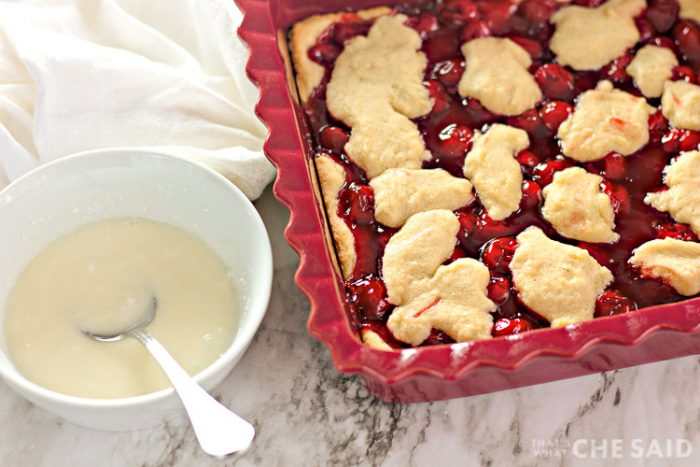 Baked Cherry Bars with Frosting in a bowl