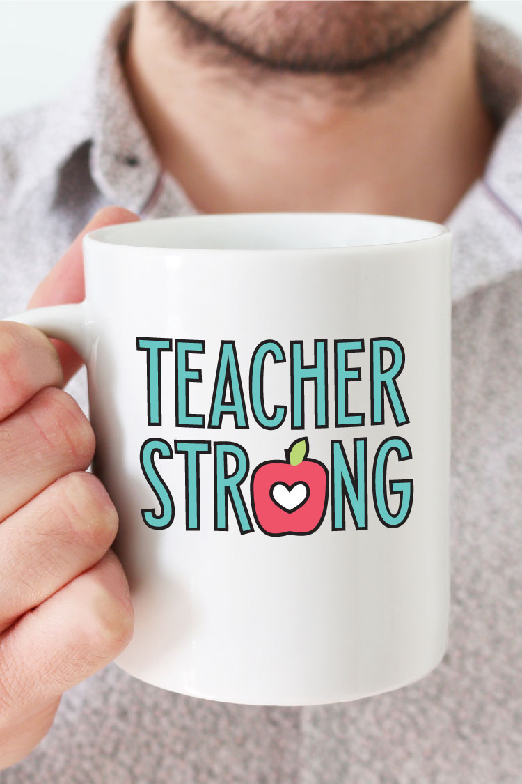 """Man holding white coffee mug with """"Teacher Strong"""" design in adhesive vinyl - vertical format"""