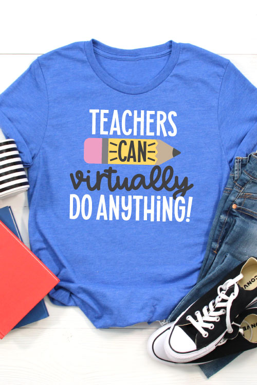 """Blue T-shirt with jeans, converse, a coffee mug and folders that has the SVG File """"Teachers Can Virtually Do Anything"""" in iron on in vertical orientation"""