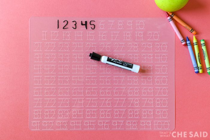 Numbers tracing mat with numbers 1-5 traced in dry erase marker