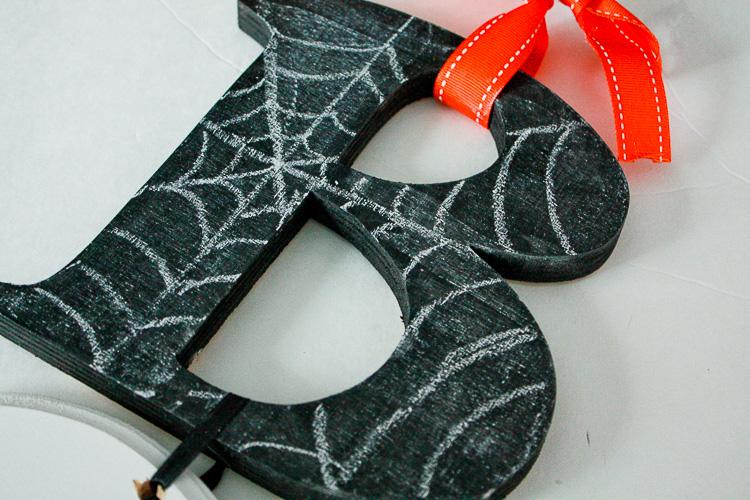 use chalk to make spiderweb