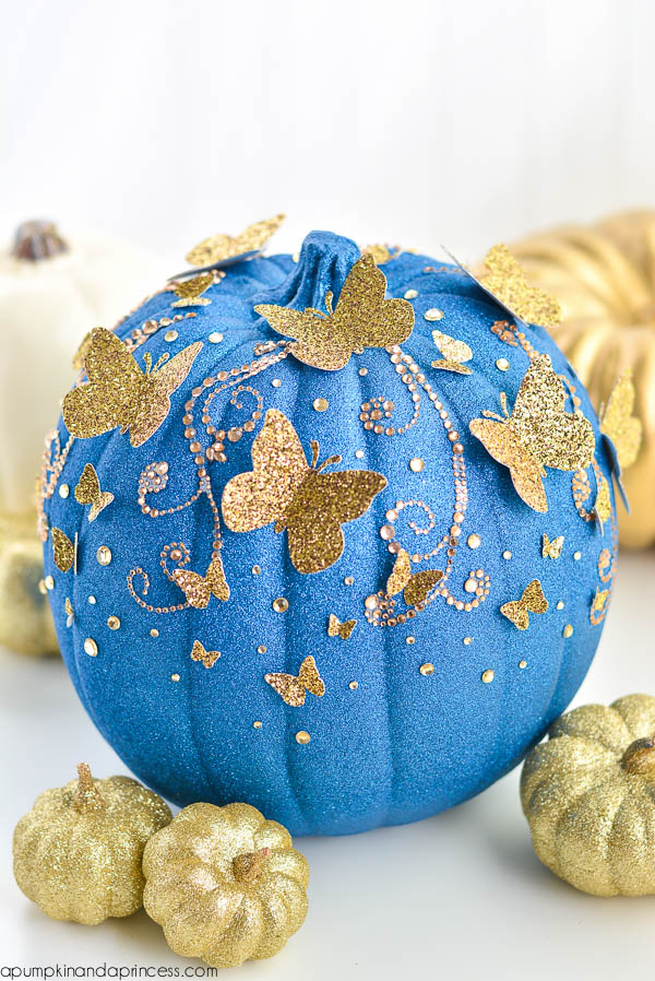 Cinderella Pumpkin. Pumpkin spraypainted blue glitter and gold accents added