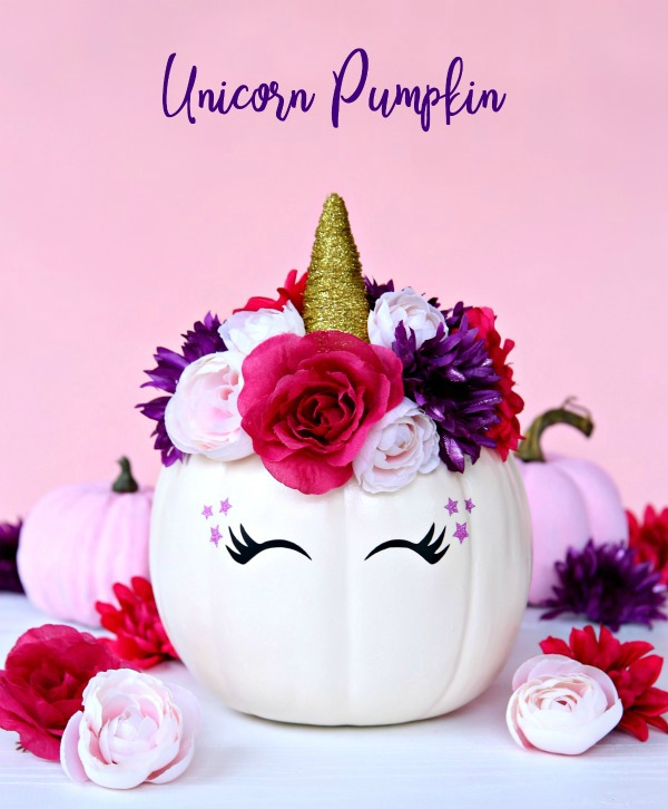White pumpkin turned into a hunicorn with horn and flowers