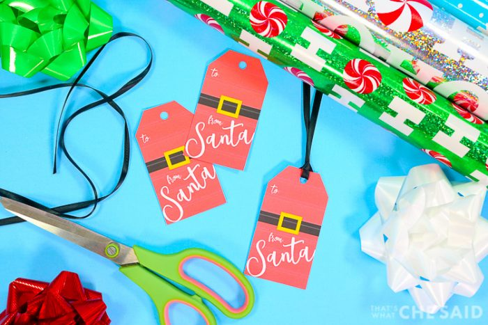 From Santa Gift Tags with gift wrap, ribbon, bows and scissors - horizontal layout