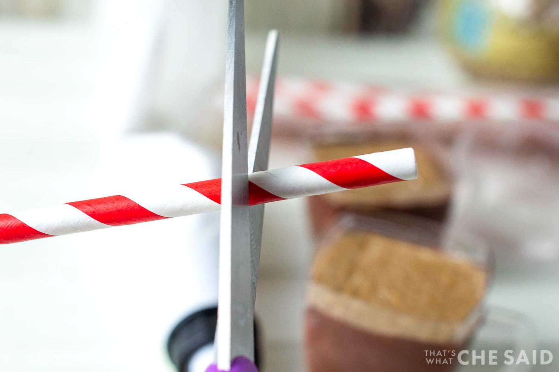 Trim a paper straw to size with scissors