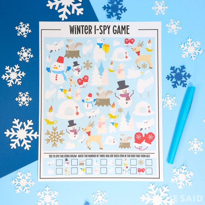 Blue background with snowflakes and the printed printable wiith a blue pen in square format