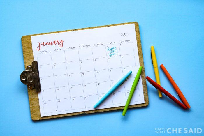 Clipboard with printable calendar and rainbow felt tip pens