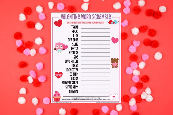 Red background with red, white and pink valentine pom poms and a Valentine Word Scramble printable in the center horizontal orientation