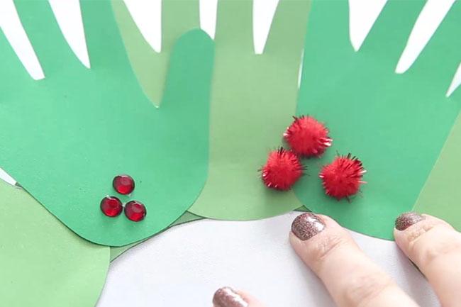 Glue Pom Poms to Handprint Wreath
