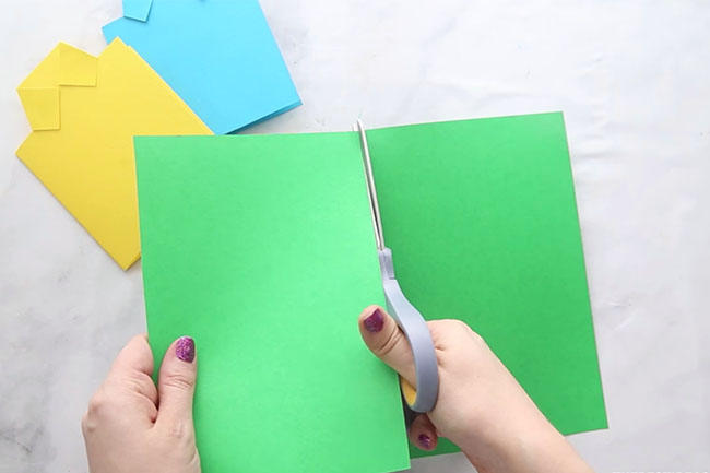 Cut a paper in half for shirt card