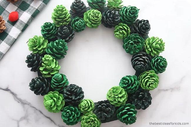 Glue Pine cones to DIY Pine Cone Wreath