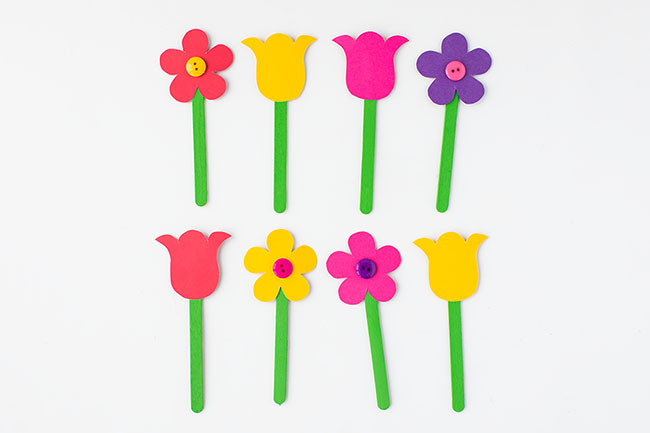 Glue Flowers to top of Popsicle Sticks
